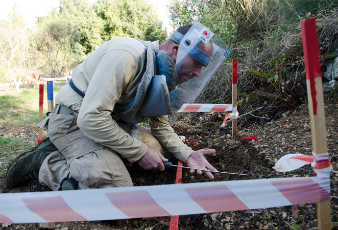 A Handicap International deminer is prodding the area and pinpoints the location of a metal object. Beginning in 2010, Handicap International has been clearing explosive remnants of war in Batroun District, North Lebanon, with the goal of having the area landmine free by 2016.